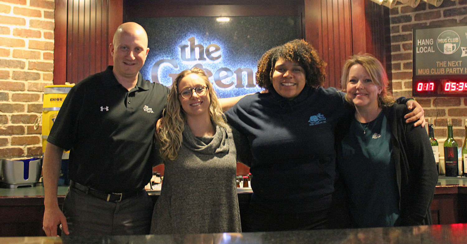 Michelle Baumann, 26, center-left, and Stephanie De Los Santos, 22, both of East Meadow, triumphed in the regional round of the Greene Turtle's fourth annual Bring Your Own Bartender competition on Feb. 22. They are pictured with Greene Turtle General Manager Brian Freund, left, and Director of Operations Katie DeSimone.