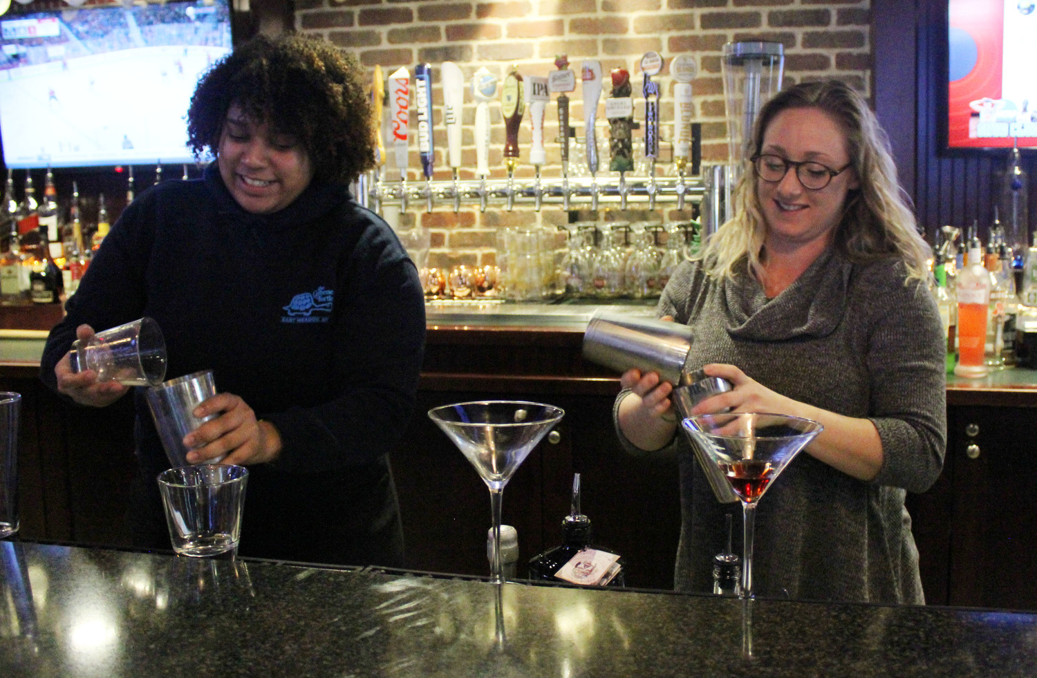 Baumann, left, and De Los Santos will be moving on to the national competition on April 13, where they will compete for a chance to have their drink recipe on Greene Turtle menus across the country.