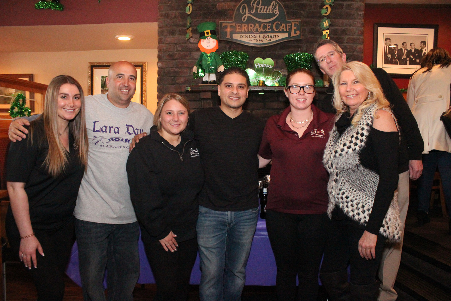 J. Paul's co-owner Joe Bonin, second from left, with staff Larissa Ango, left, Courtney Collins, Juan Roca, Laura Raimondo, Billy Doyle and Deb Collier during the restaurant's Lara Day fundraiser on March 10.