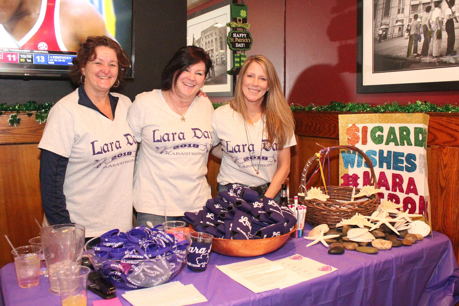 Keeping track of the many raffle baskets were Jodi Ficarra, left, Peggy Melito, and Shae Santamaria.