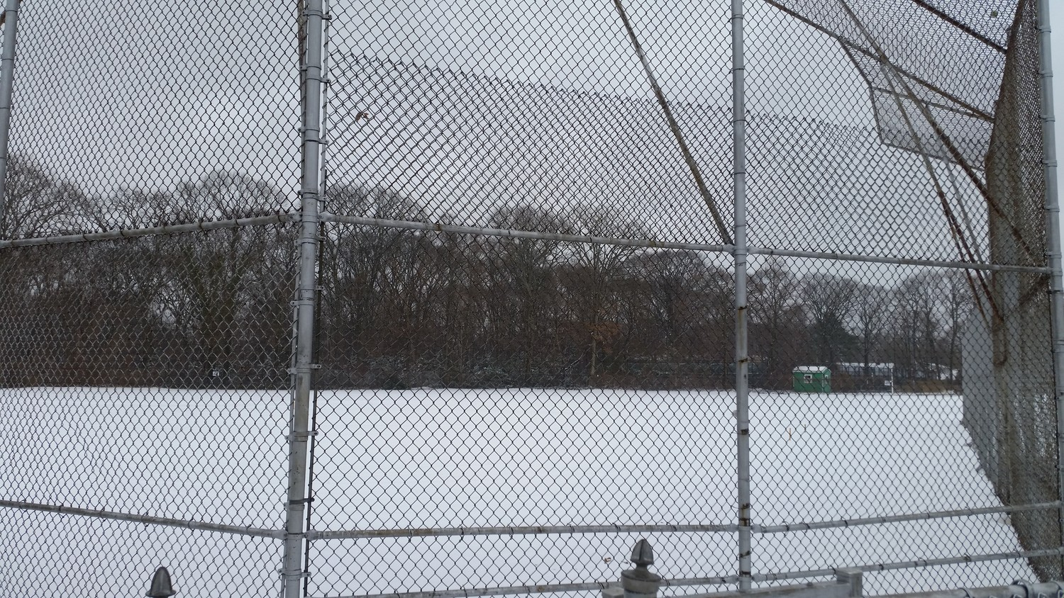 A ballpark on Woodfield Road in Lakeview covered in snow on the second day of spring.