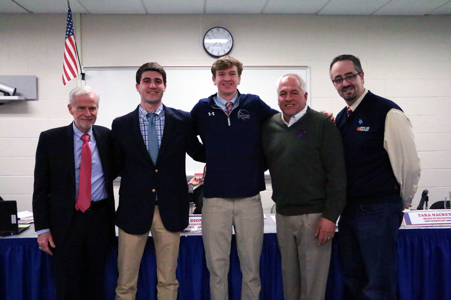 Matthew Trencheny, second from left, and teammate Ryan O'Shea, earned All-County honors this season. They joined their coach Jerry D'Angelo, right, Schools Superintendent Dr. William Johnson, far left, and Board of Education President John O'Shea during a school board meeting on March 14.