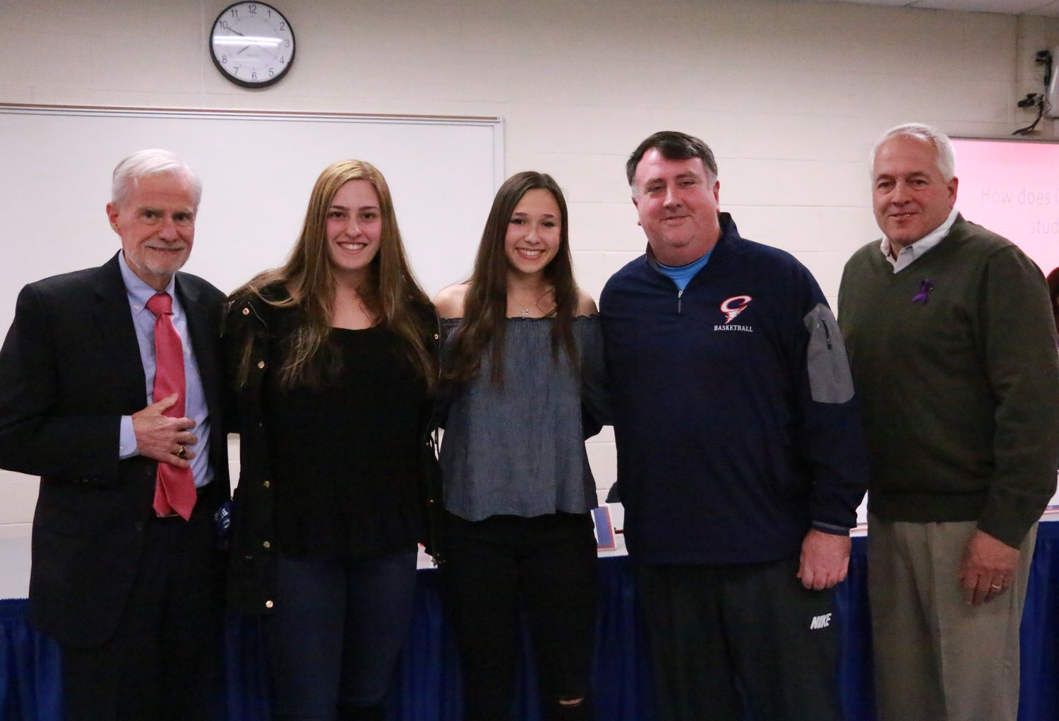 Gianna Mauro and Jenna Lopez, with their coach, were honored.