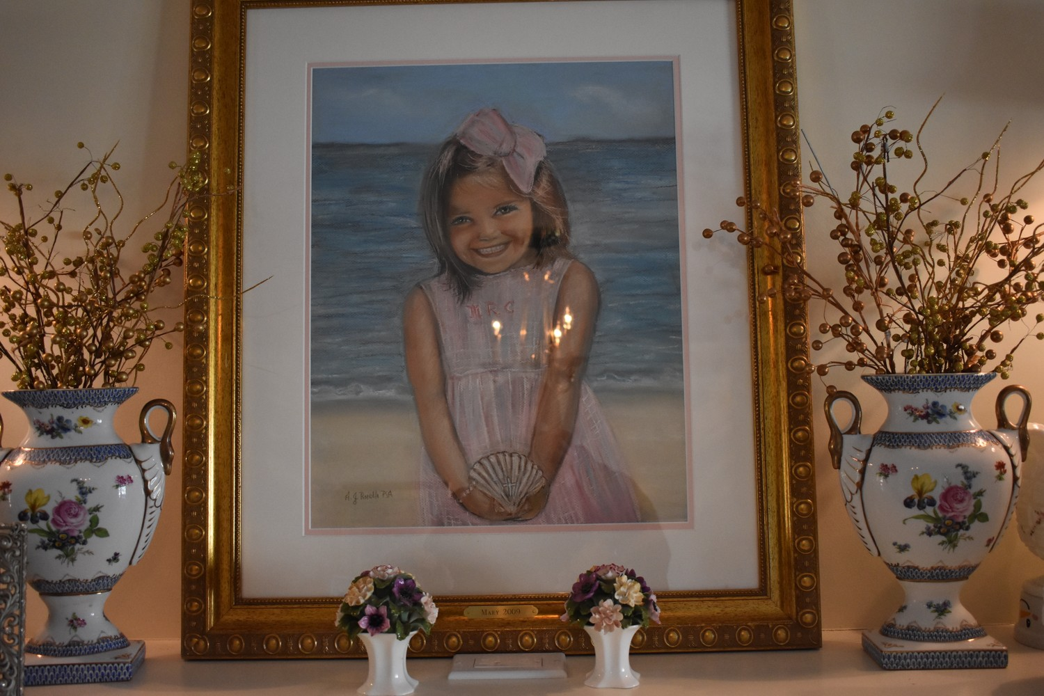 A drawing of Mary, based off a photo of her at Sag Harbor, sits on the Ruchalski family's mantle.