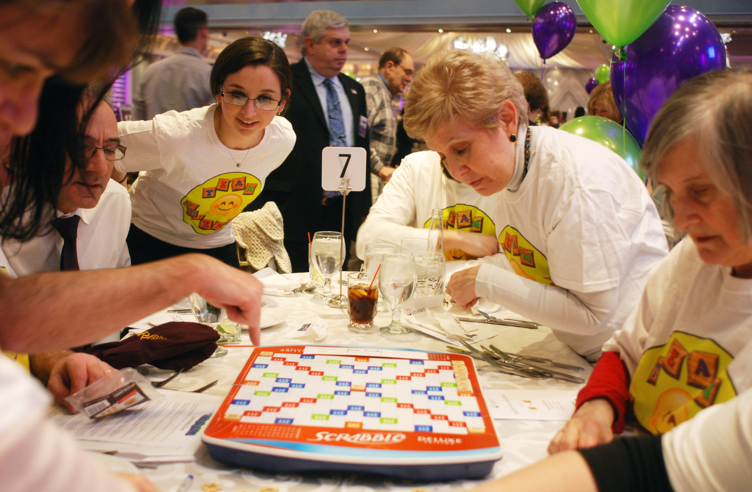 Meredith Chesler, back left, joined her team, including, at right, Lynn Brown and Lyn Dobrin, in a competitive game of (un)Scrabble at Literacy Nassau's 50th anniversary gala at Chateau Briand in Carle Place last Thursday.