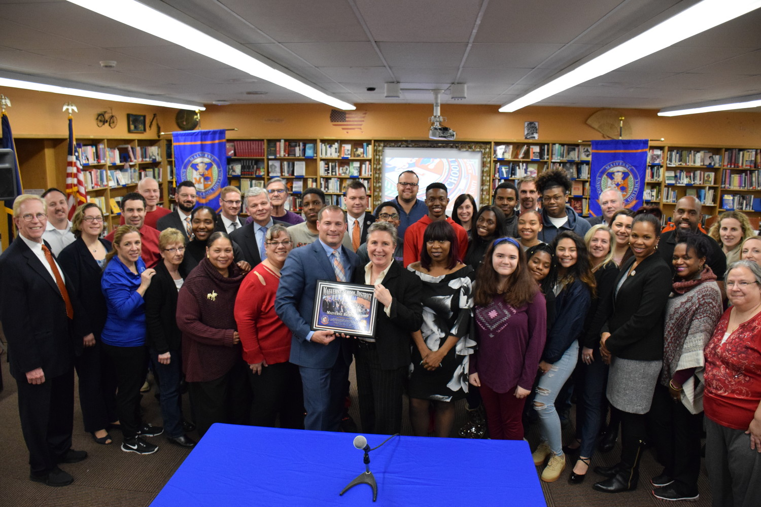 Malverne School District board members, administrators, high school teachers and students received a plaque from SUNY Albany for being featured in its NYKids study.