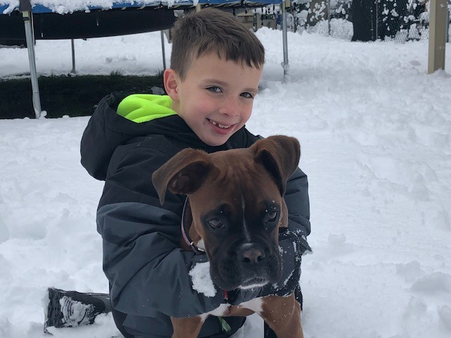 Joaquin Pagan and Scout played in the snow.