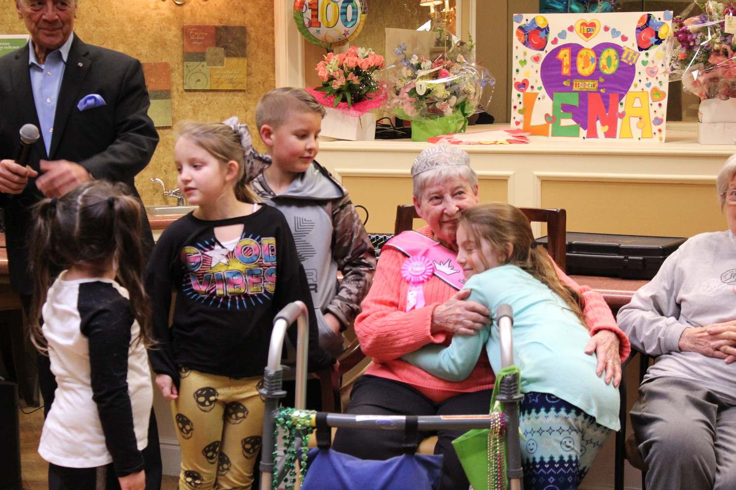 Lena Conte was surprised by her great grandchildren Gianna, left, Alexa, Richie and Lily for her 100th birthday celebration at the Lynbrook Atria on March 12.