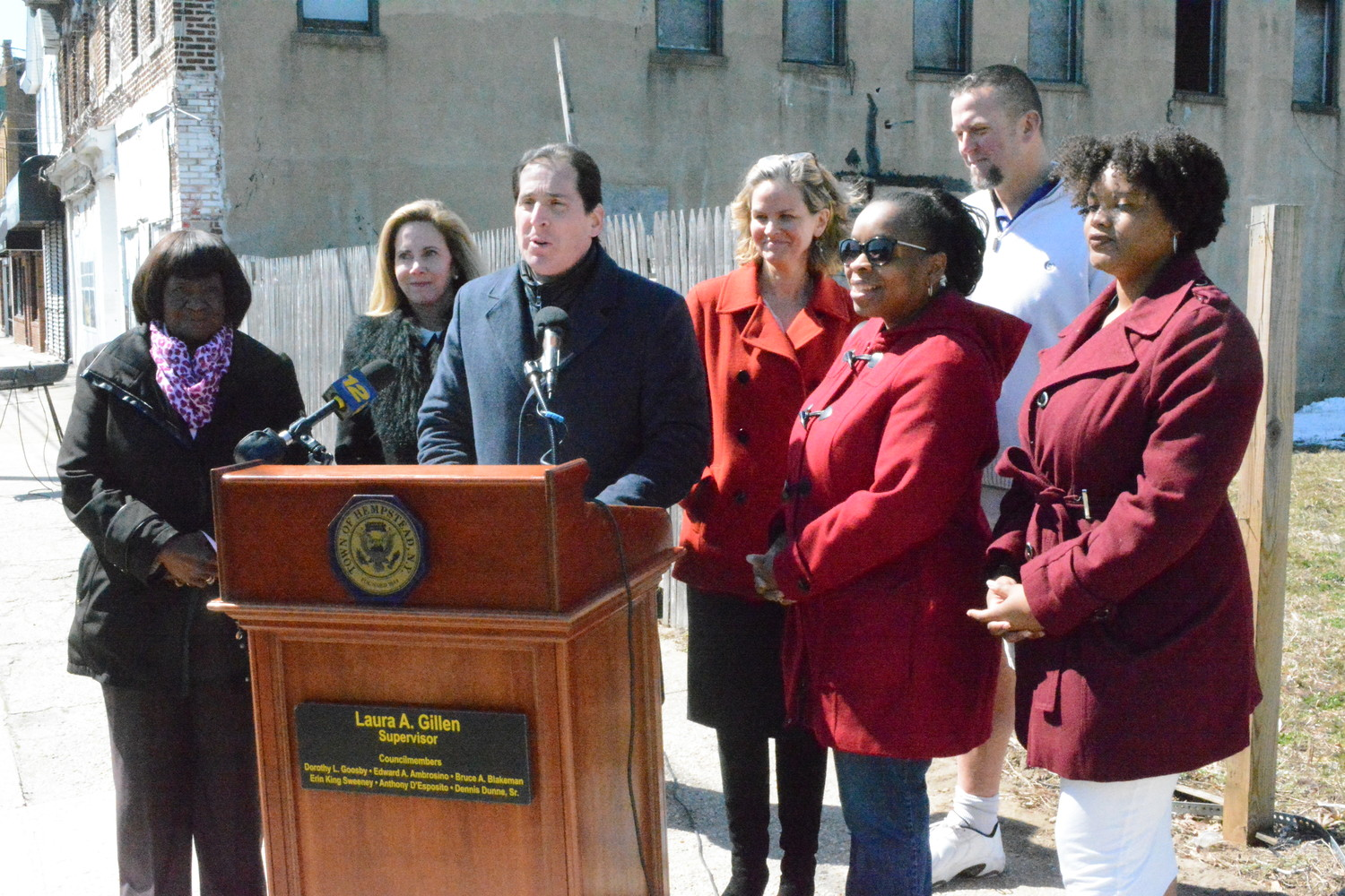 Sen. Todd Kaminsky, at lectern, announced a $1 million state grant for Baldwin's downtown development on Monday. Joining him, from left, were Town of Hempstead Councilwoman Dorothy Goosby, Town Supervisor Laura Gillen, County Executive Laura Curran, Board of Education Trustee Karyn Reid, Chamber of Commerce President Erik Mahler and legislative assistant Kiana Bierria-Anderson.