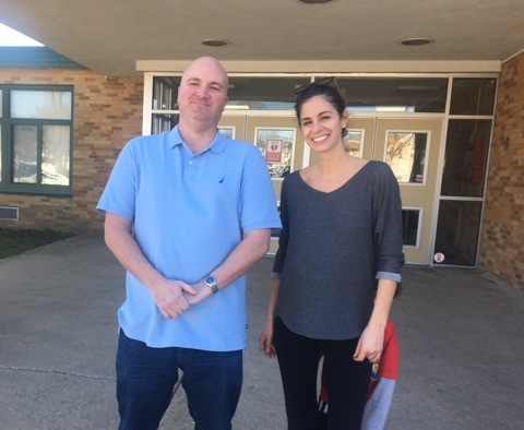 Seaford parents - Chris Carini and Audrey Saracco - stand in front of Seaford Manor Elementary School. They're urging the Seaford Board of Education to hold a public town hall meeting about school safety.