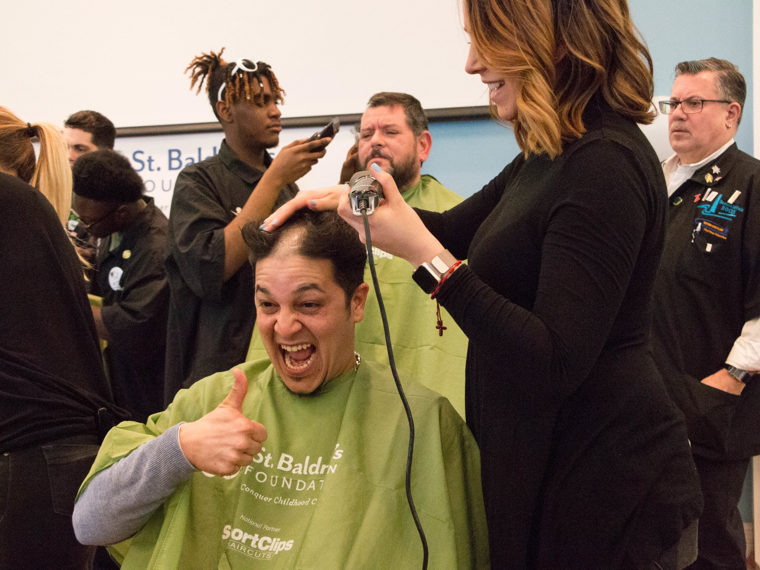 Juan C. Bosques got his head shaved at the St. Baldrick's fundraiser in Rockville Centre last year, which was attended by more than 200 shavees and ponytail donators and helped raise about $450,000.