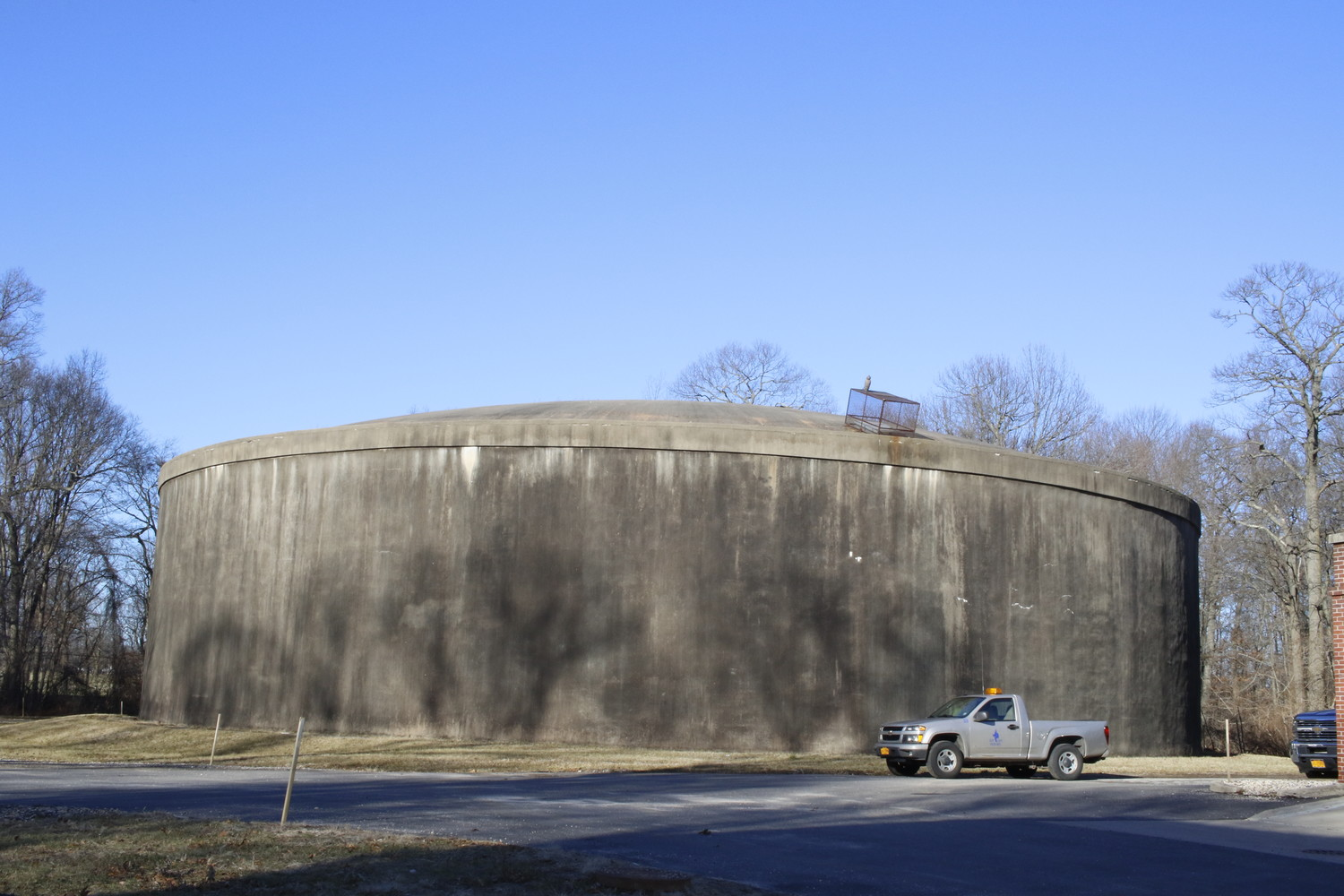 "The water storage tank at the Duck Pond Road well facility, where one well was recently re-opened following two months of testing where Freon levels were ""undetectable."" A special filter is expected to be installed in early summer will allow the other closed well at Duck Pont to re-open."