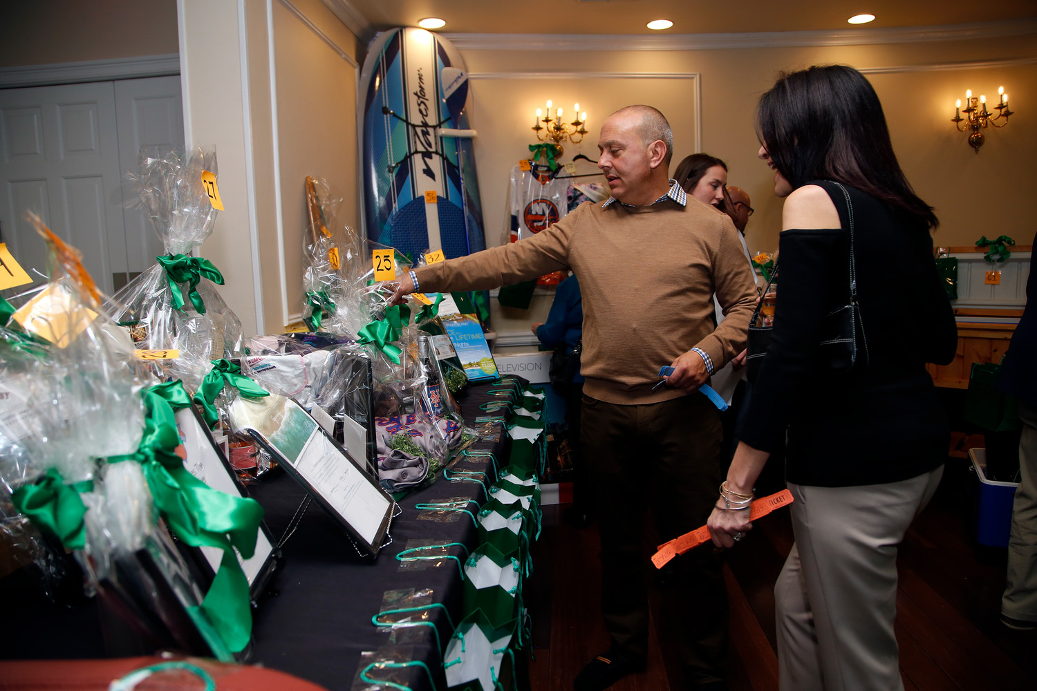 Lou and Claudina Barbella looked at some of the 300 raffle baskets.