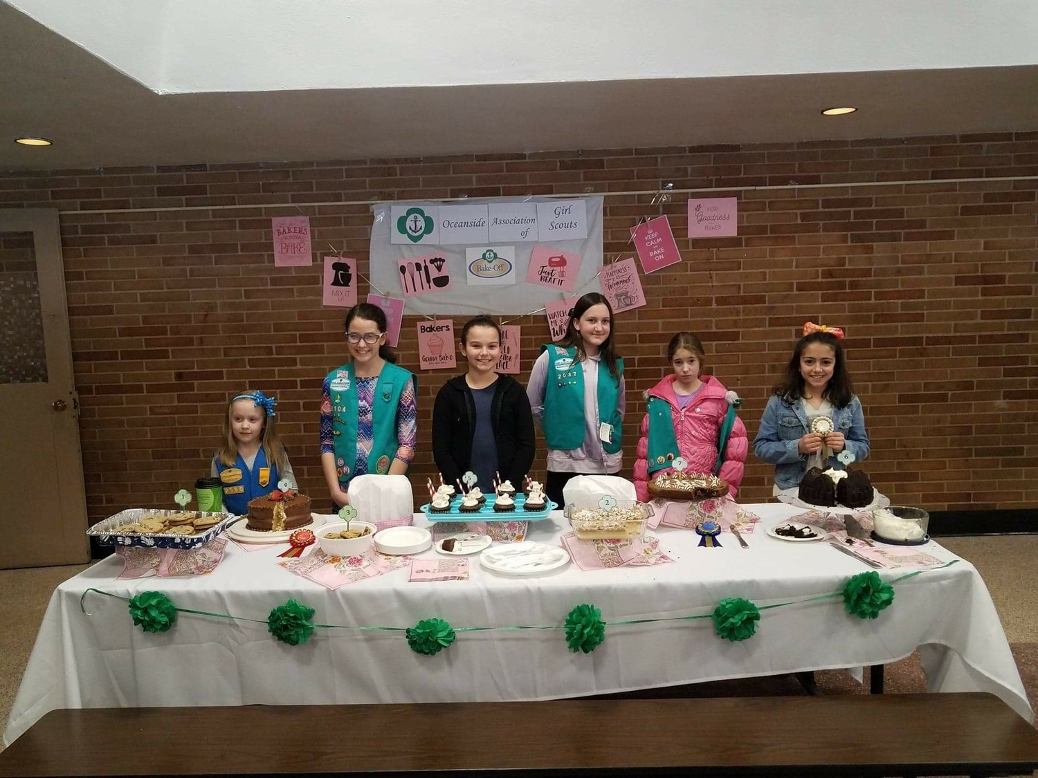 Oceanside Girl Scout members, Lilly Miller, left, Kaitlyn Rey, Riley Brasch, Kylee Griffin, Skylar Parker and Eliana de la Teja with their submitted cakes for the bake off.