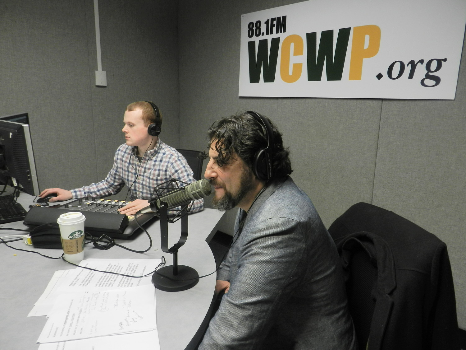 Jason Samel, a resident of Old Brookville, pre-records his interviews in the studio at WCWP on LIU Post's campus.