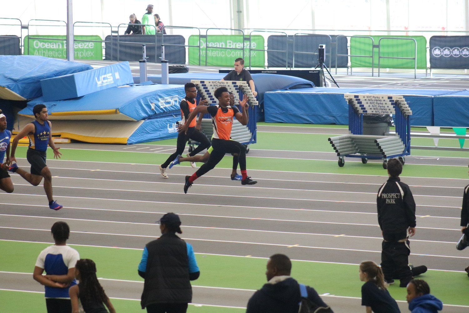 Two runners from Explosion Track Club, Andrew Decoteau and Julian Desrosiers, competing at a recent meet.