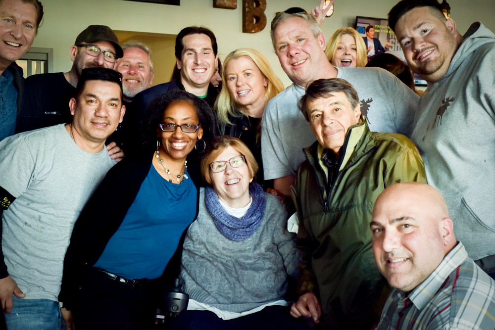 Residents, elected officials and friends of West End resident Liz Treston, bottom center, organized a fundraiser at the Knights' Pub on March 24 to raise money to help rebuild her Hurricane Sandy-damaged home. Treston has been displaced since the 2012 storm.