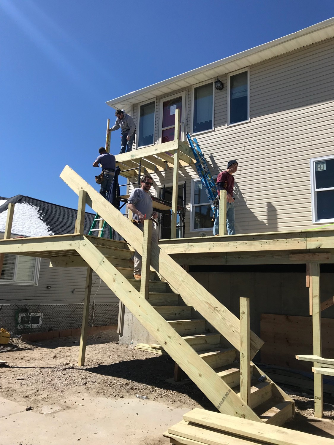 Friends, neighbors and volunteers helped rebuild West End resident Liz Treston's deck on March 24.