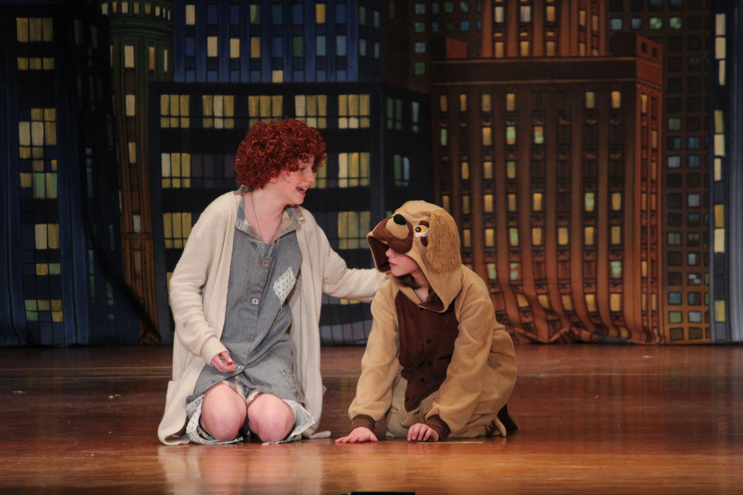 In the Baldwin Middle School production of Annie Jr. the roles of Annie and Sandy, her dog, were played by Skylar Smith and Samantha Lignowski.  The cast and crew were faced with losing several rehearsals to winter weather, but they pulled through and put on a great show.