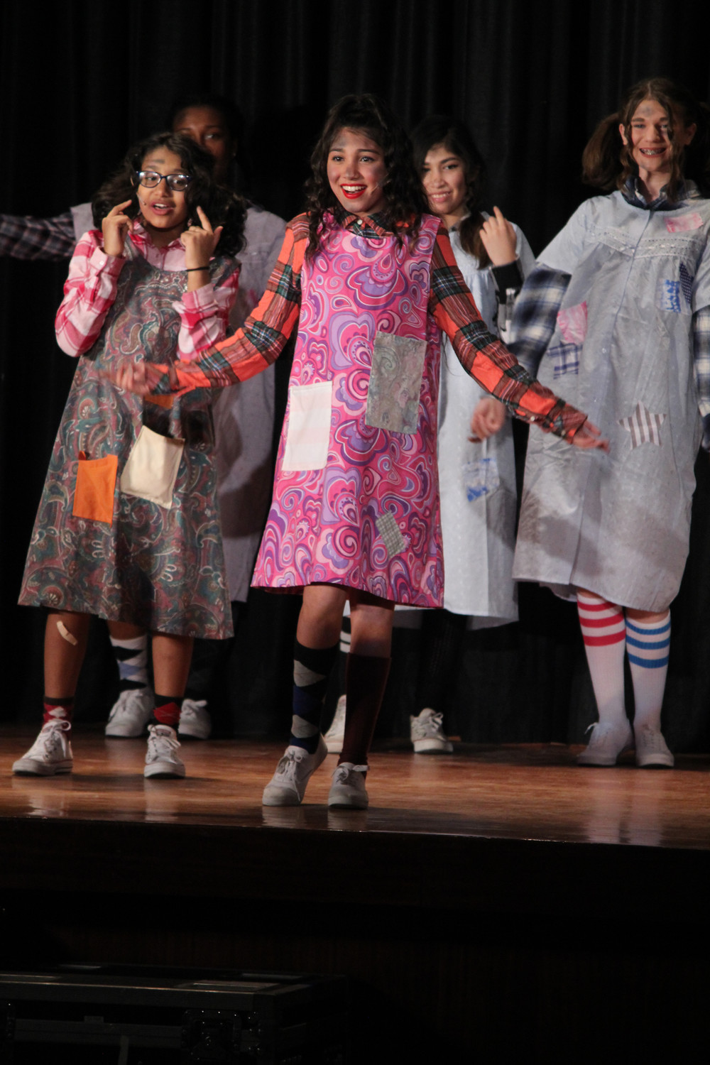 Rubena Malik, an 8th grader, plays one of the orphans in the Baldwin Middle School production of Annie Jr.  Despite the rehearsal schedule being challenged with the snow day last week, the three shows went off without a hitch.