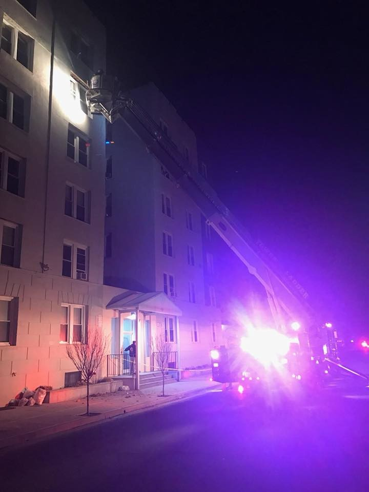 Police and fire officials rushed to 215 East Broadway Saturday morning where loose bricks were falling from the fifth floor of an apartment building.