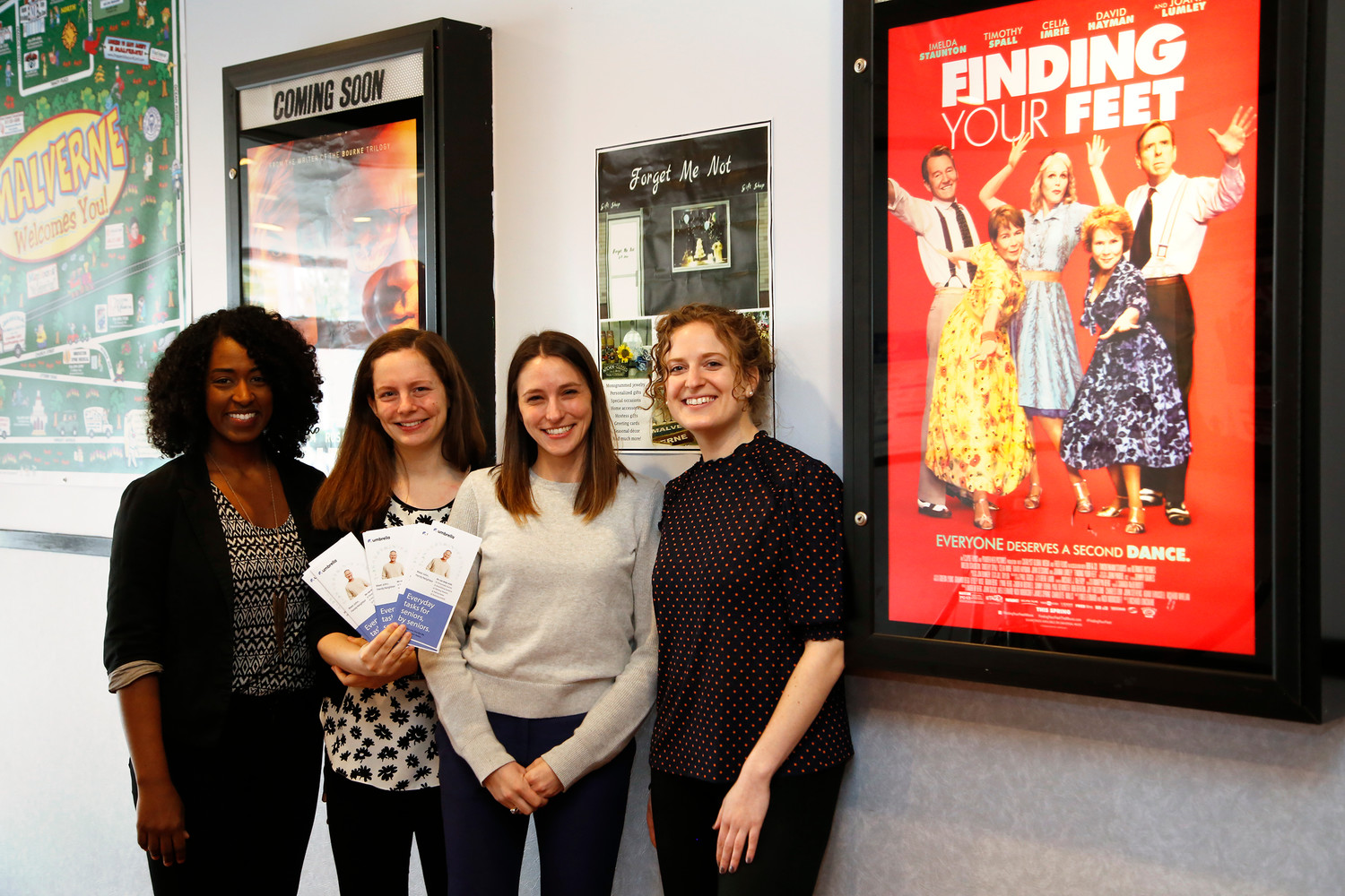 Umbrella staff members, from left, Samra Brouk, Emma Gilsanz, Lindsay Ullman and Erin George introduced their program to residents at the Malverne Cinema last Friday.