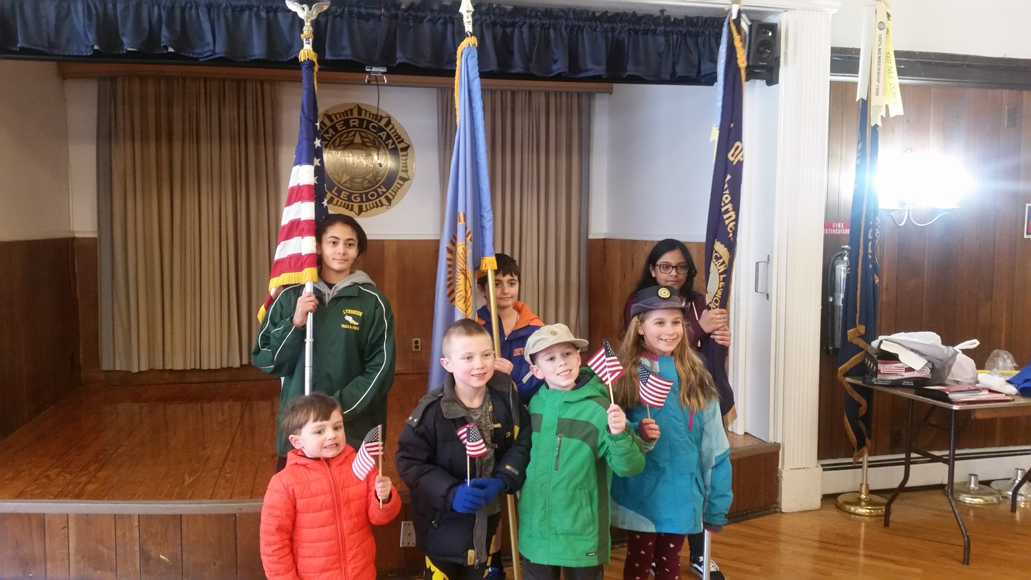 Children held the flags of Post 44 with pride.