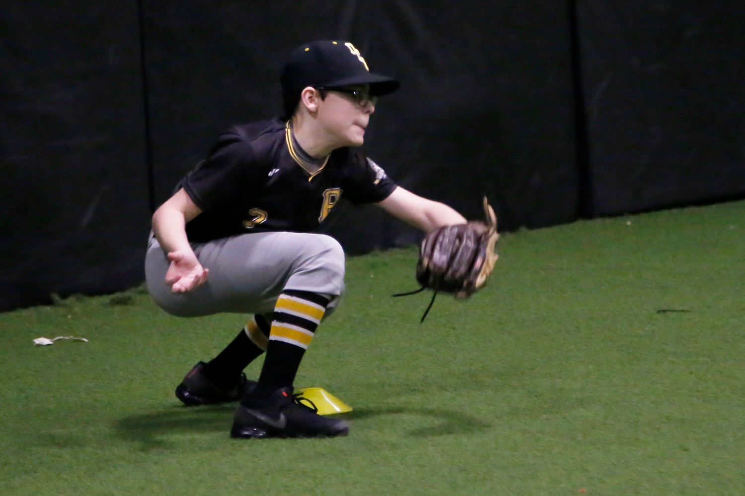 12-year old Josh Sepe from Hewlett practices sweeping the base.