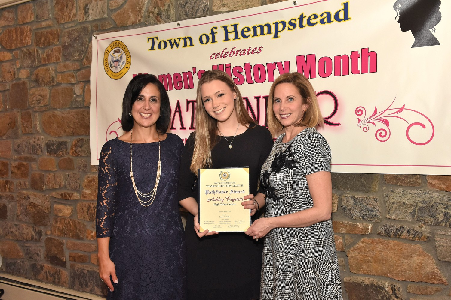 Ashley Cegelski was honored at the 2018 Pathfinder Awards by Town of Hempstead Clerk Sylvia Cabana, left, and Town Supervisor Laura Gillen.