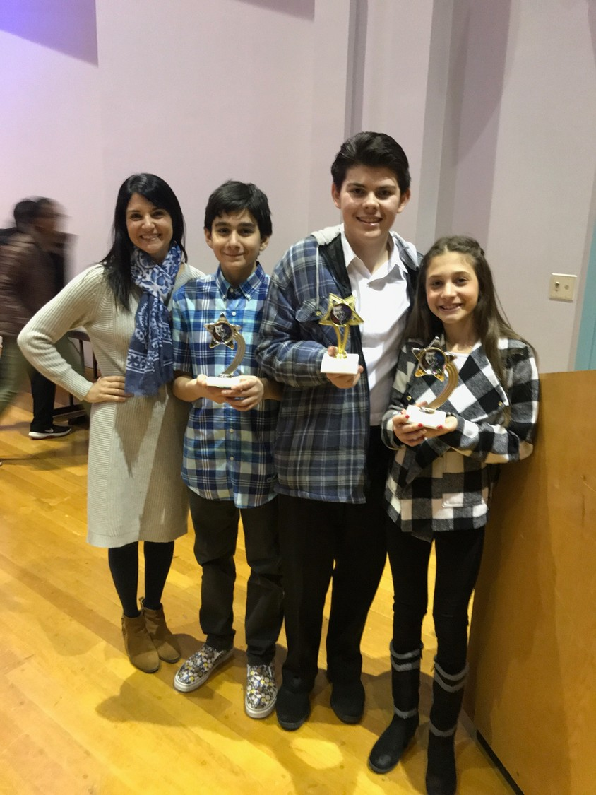 "Lynbrook students Jaiden Moreno, second from left, David Padilla and Emilia ""Mimi"" Berkowitz took first through third place, respectively, at a recent Honors Program science fair.  Above, the students with their coach, Roxanne Migliacci."