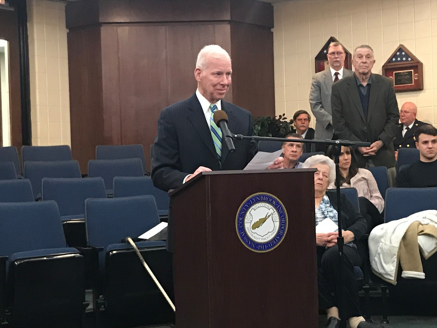 Village Attorney Peter Ledwith addressed the audience at the Lynbrook village board meeting on April 2 to reflect on his 41-year career upon his retirement.