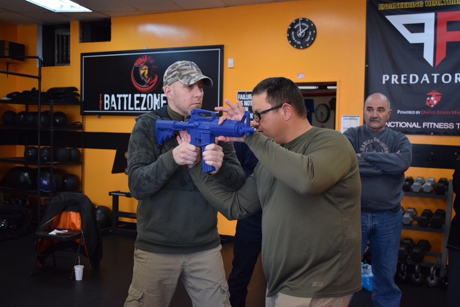 Franklin Square's Tommy DiLallo, left, and Defense Techniques Academy instructor Carlos Roman recently taught students at the Battle Zone Gym how to disarm an active shooter.