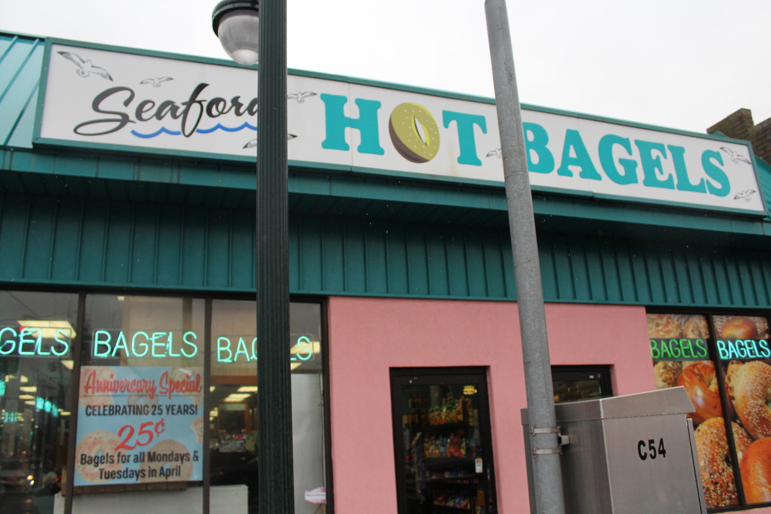 The Seaford Bagels façade, at 3970 Merrick Road in Seaford, looks as if it could fit on Miami's beachfront.
