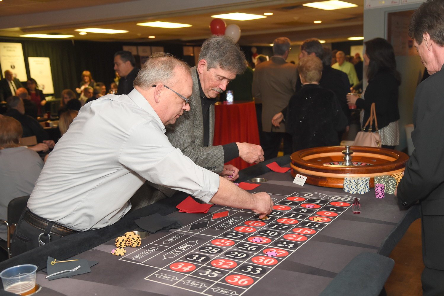 Randy Schiffelbein, left, and Gary Reusch, of Valley Stream, played roulette during Monte Carlo Night at the Sandel Senior Center last Saturday.