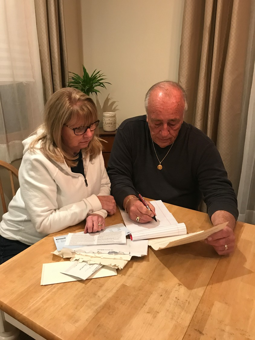 Maryann and Ron Daly, of Wantagh, with the paperwork detailing the lifting of their Sandy-damaged home, which has not yet taken place.