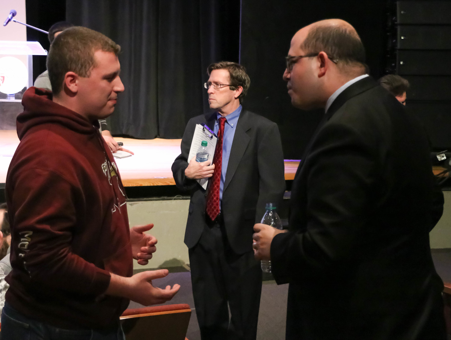 Lou Mazza, left, a freshman at Molloy College, spoke with Stelter after calling him out for having a liberal agenda.