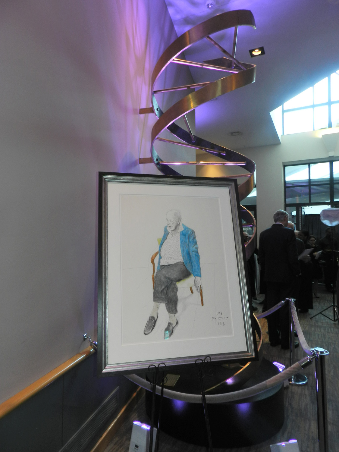 A drawing by David Hockney depicting Dr. Watson, alongside a steel structure of DNA, was displayed in the cocktail area during the party.