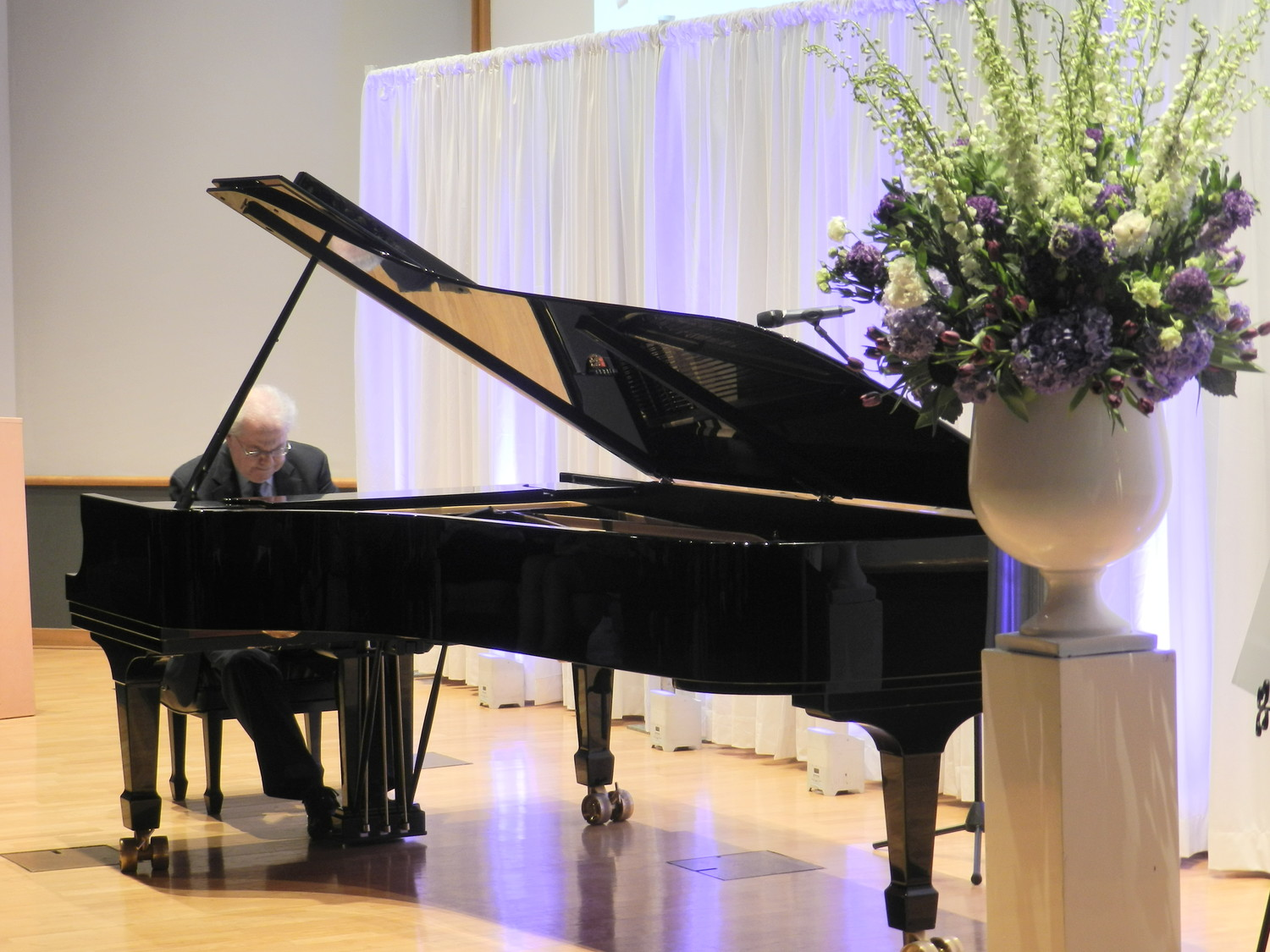 Classical pianist Emanuel Ax performed a few numbers for party guests as a gift to Dr. Watson