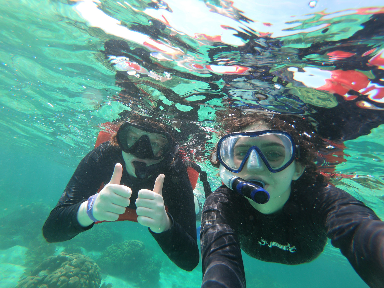 Students and teachers from North Shore High School traveled to Belize during spring break, where they learned a great deal. Emma Spina, left, and Zoe Malin studied marine life up close.