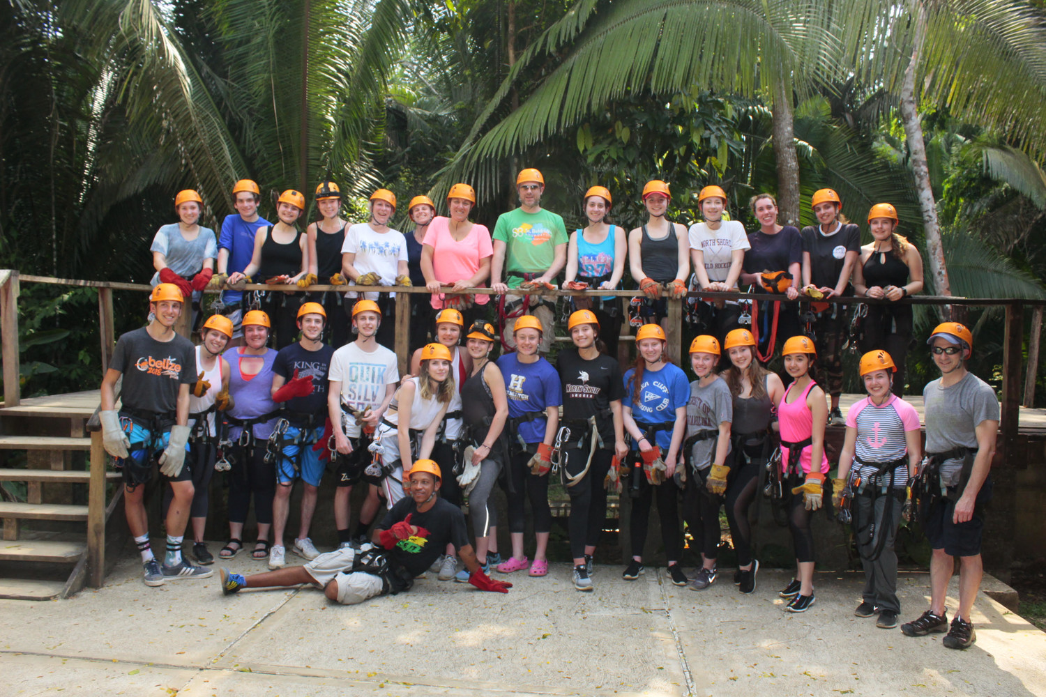North Shore High School students and faculty donned safety gear before zip lining through the trees of Belize
