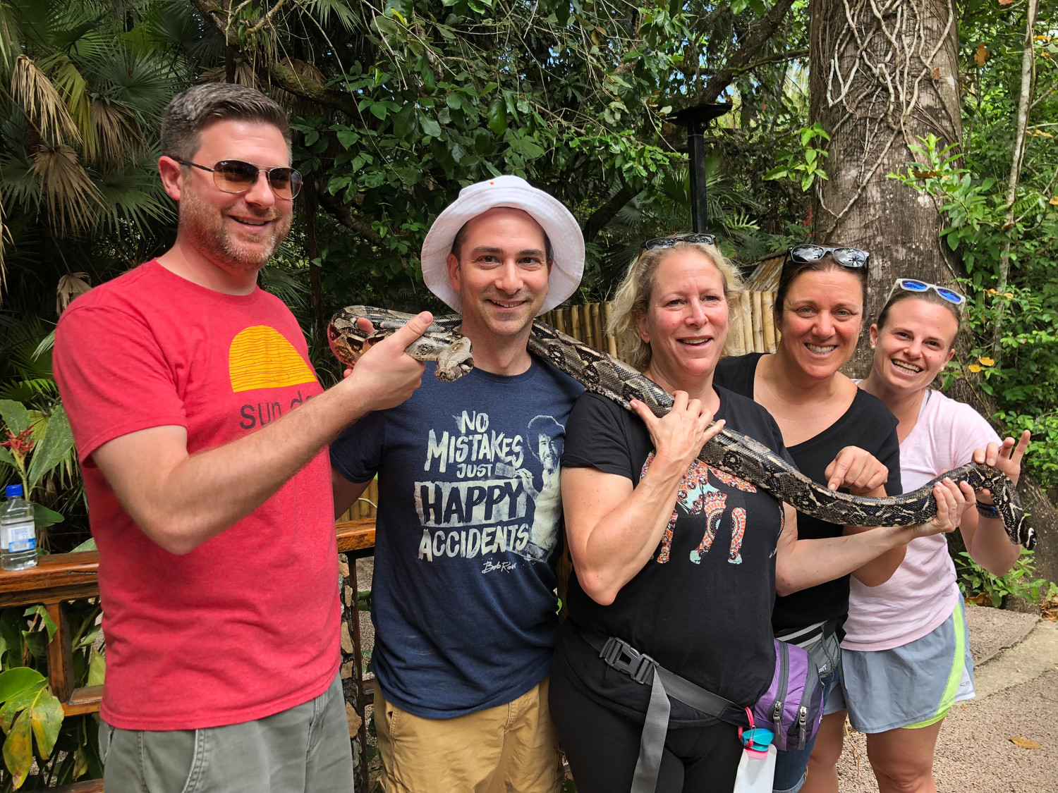 Teachers Joshua Timlin, Seth Klein, Nancy Cunningham, Mary Alice Kelly and Dana Francis made a new friend while walking through the jungle.