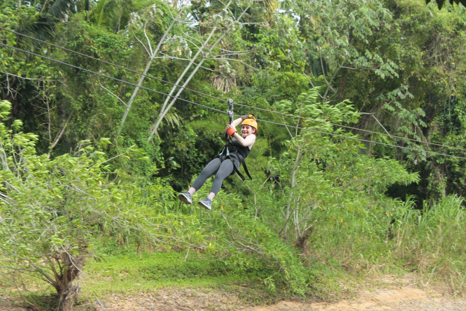 Herald Gazette intern Zoe Malin held onto her helmet as she zip-lined.