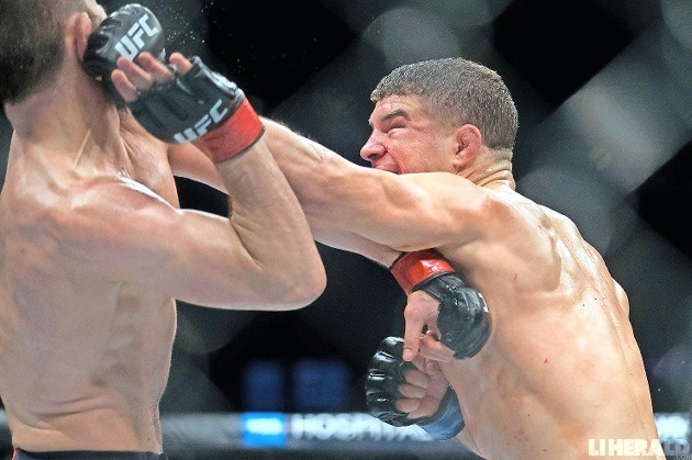 Al Iaquinta, right, of Wantagh, went the distance in last Saturday's MMA main event against unbeaten Khabib Nurmagomedov.