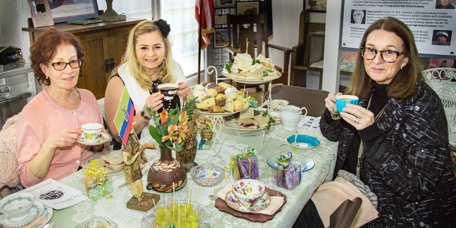 Therese Hoarty, left, Madlen Young and Sylvia Tirella sipped tea at the Long Beach Historical Society's International Tea Party on April 8 while the keynote speaker, Barbara Flak, discussed the history of tea.