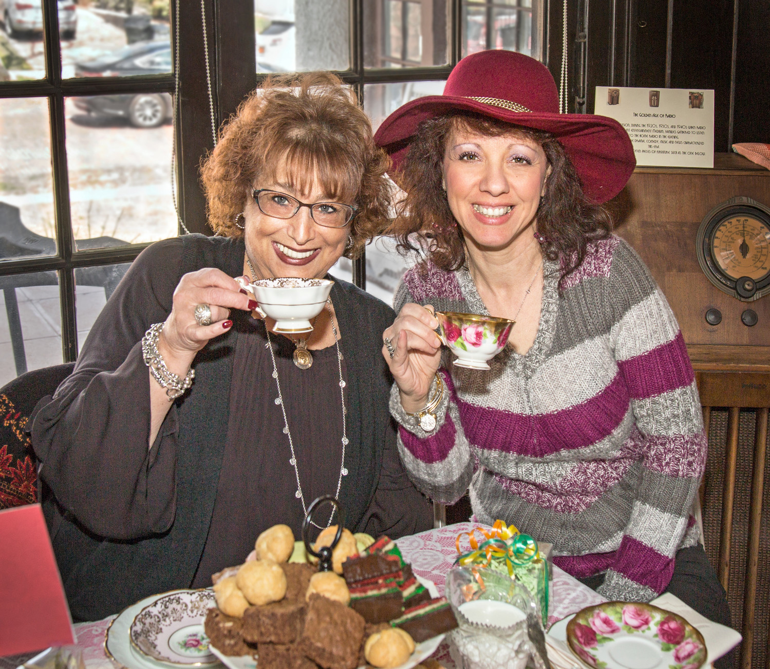 Lynbrook residents Audrey Korn, left, and Marianna Marano sipped tea at the party.