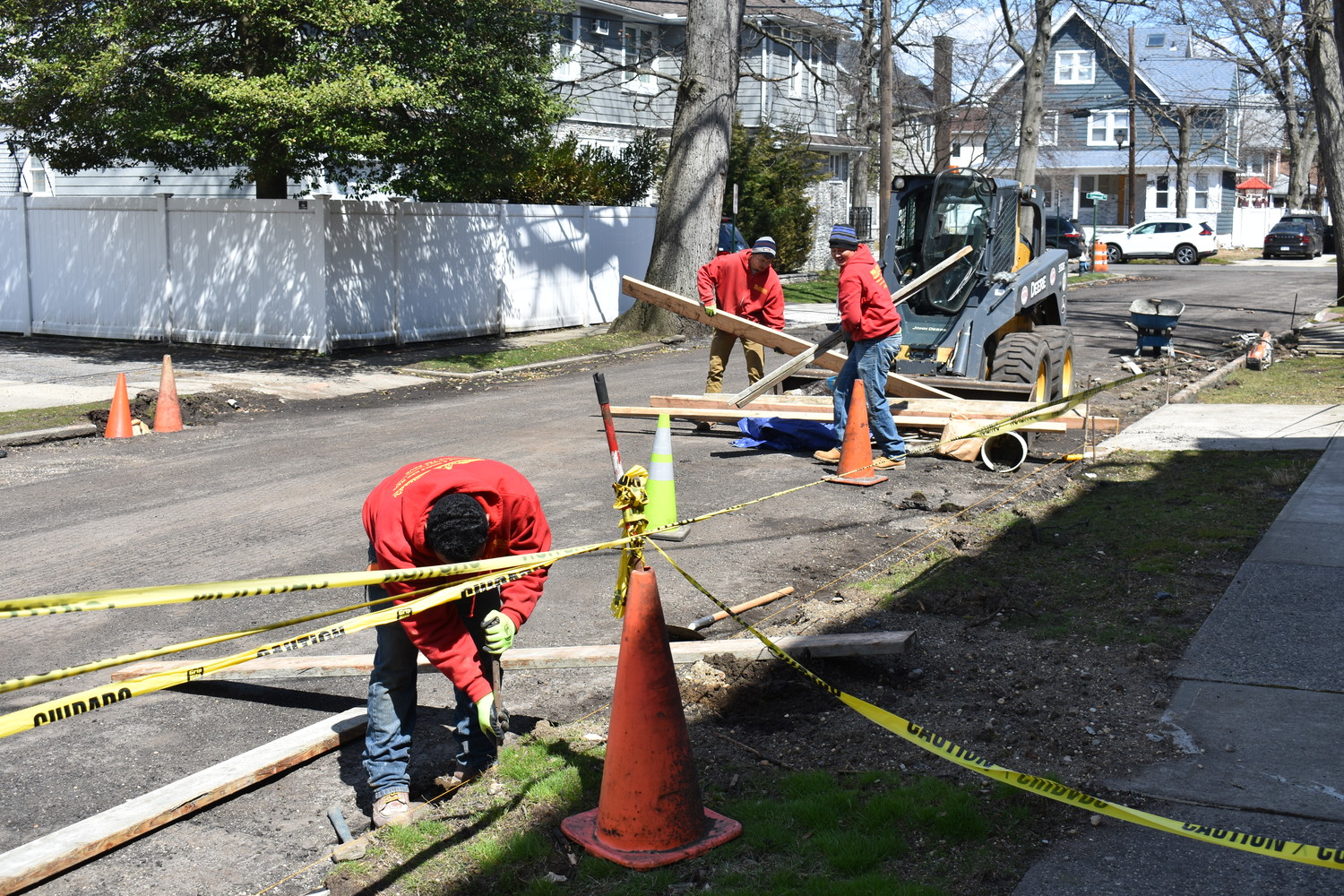 American Paving and Masonry Corp. workers repaired the curbs on Park Place in Cedarhurst
