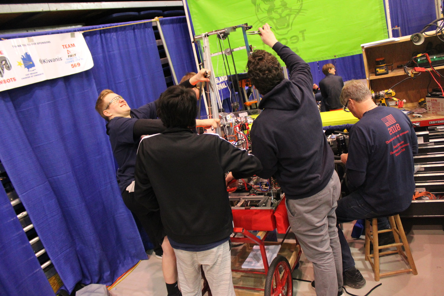 Students spend six weeks constructing their robots prior to the competition and, in between rounds, must repair them and get ready for the next game to begin.