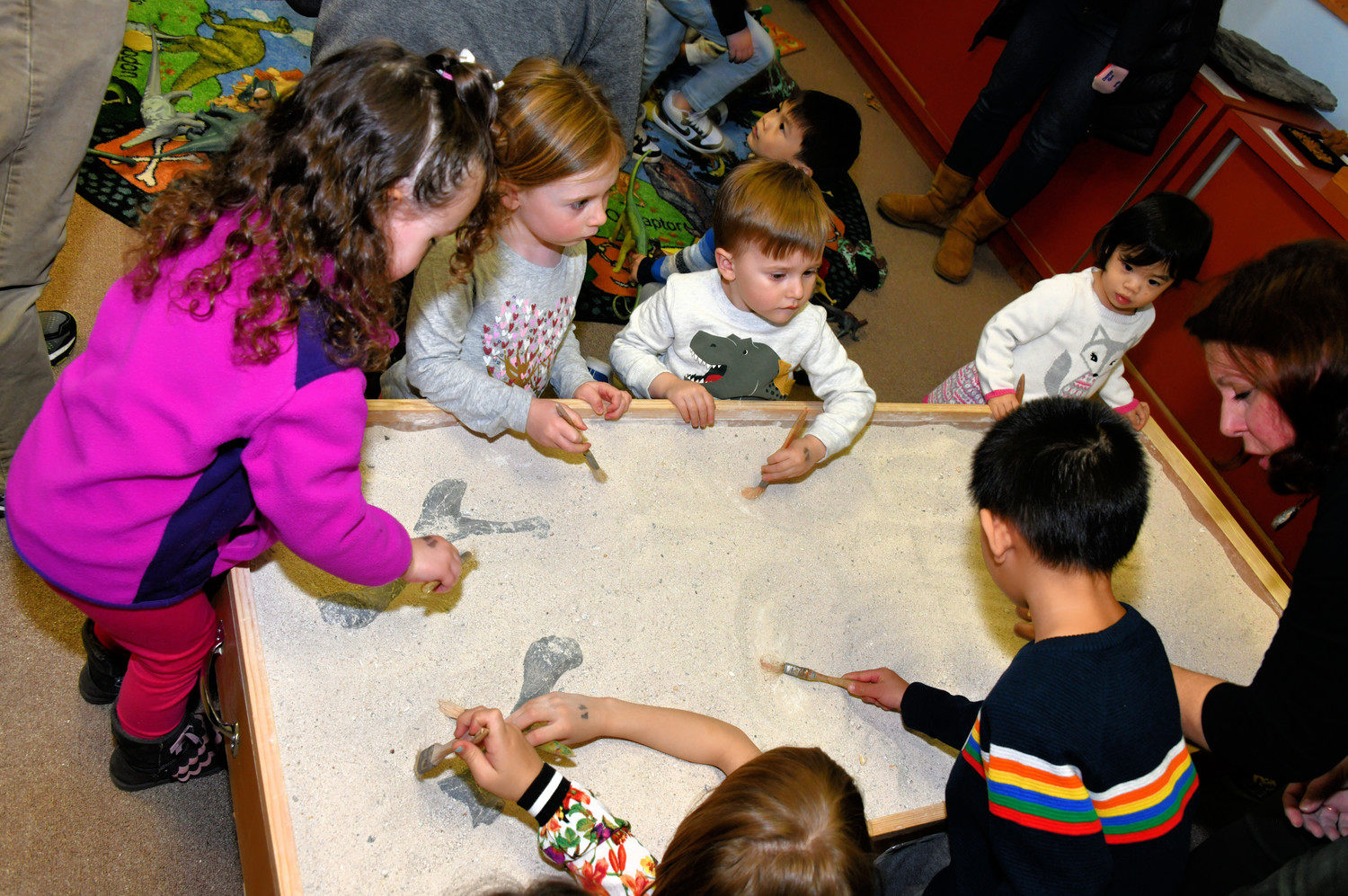 Local children became archaeologists for the day while digging for dinosaur bones.