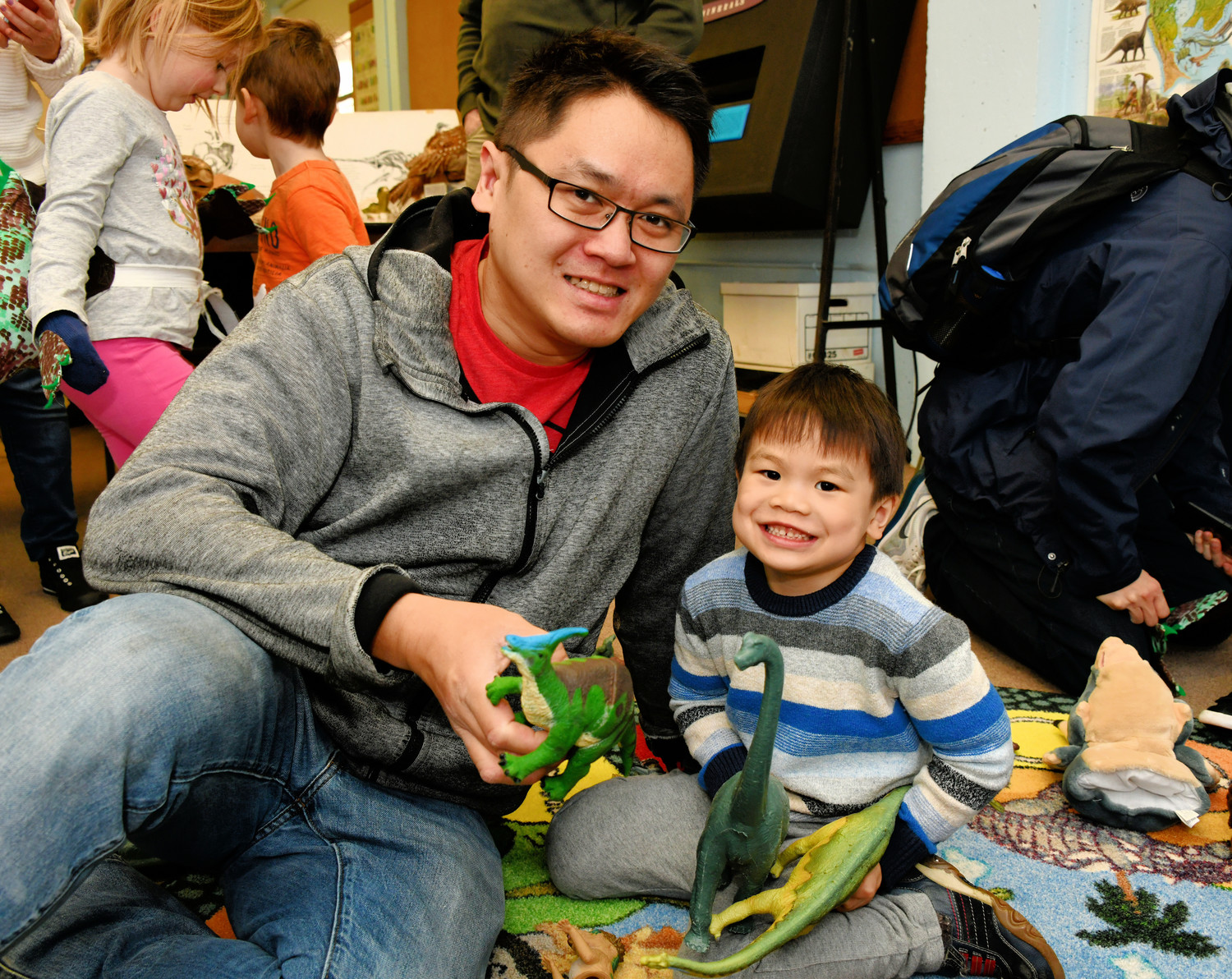 Leo and Ben Li played with dinosaur toys at Garvies' Dino Day.