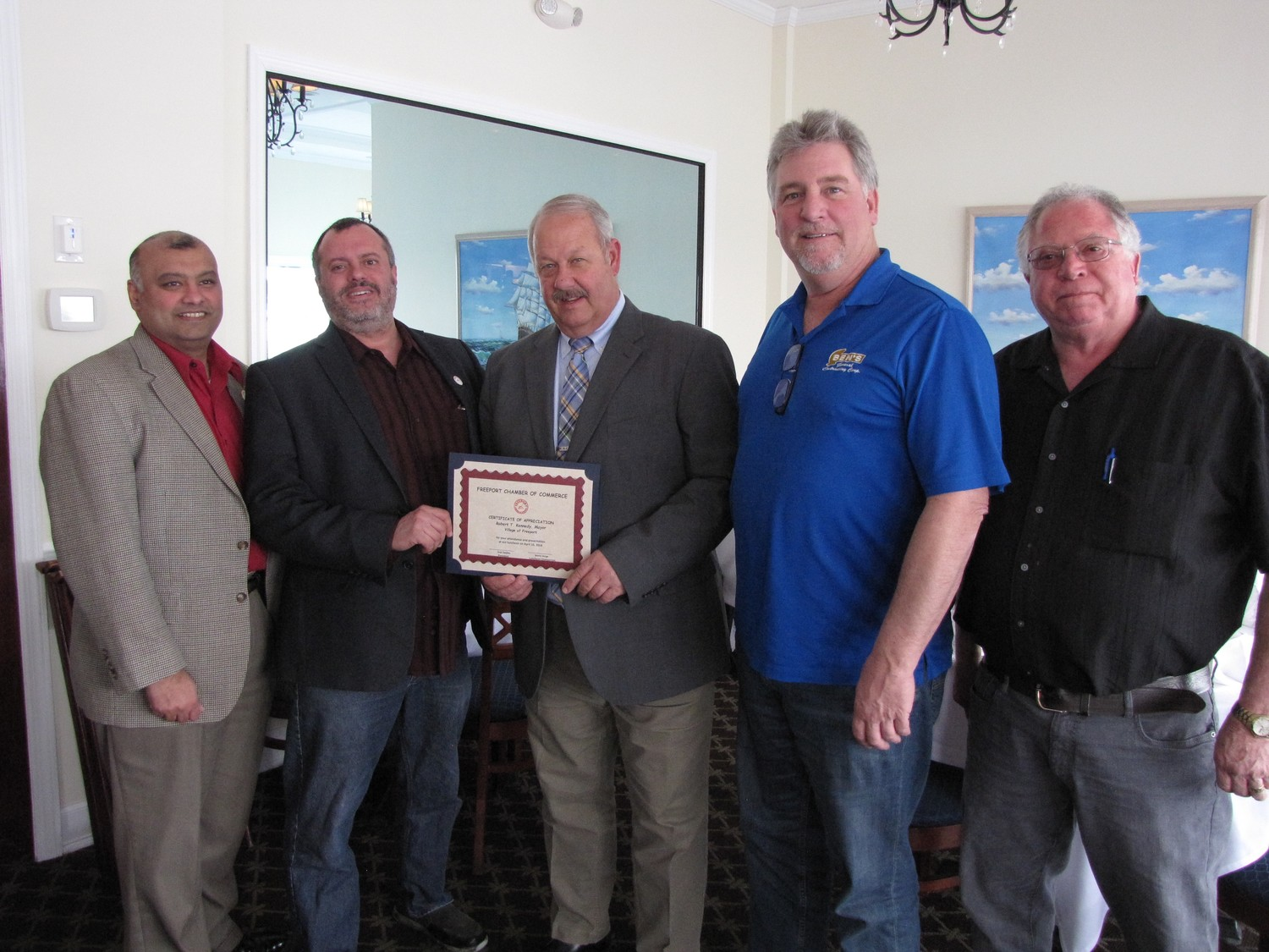 Freeport Mayor Robert Kennedy, center, received a citation from Chamber of Commerce members, from left, Ken Dookram, President Ivan Sayles, Ben Jackson and Thomas Dipolito at a luncheon on the Nautical Mile on Tuesday.